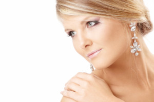Portrait of the beautiful blonde with jewelry, isolated